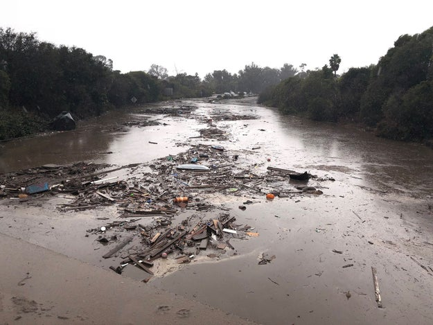 The floods and mudslides have shut down more 30 miles (48km) of the main coastal road.