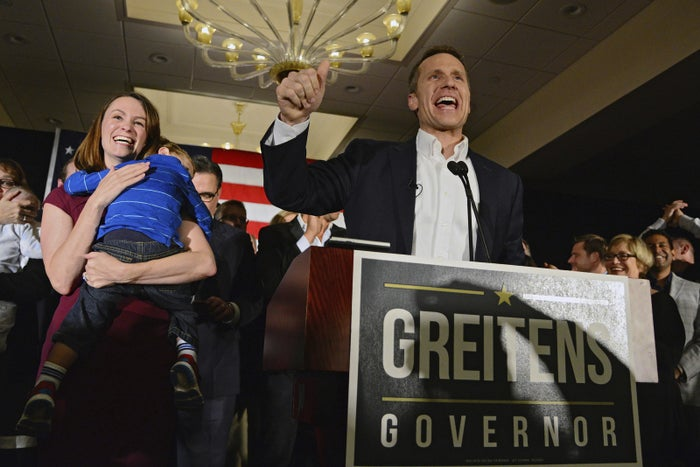 Missouri Republican Governor Eric Greitens delivers a victory speech alongside his wife Sheena and son Joshua in 2016.