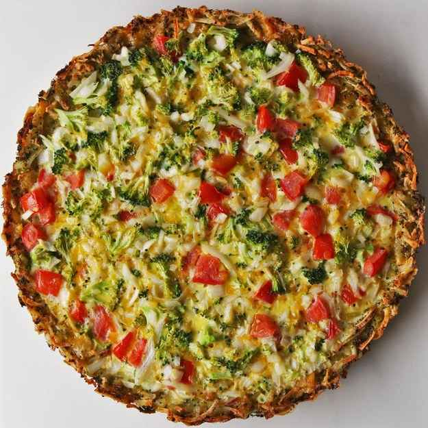 8 servingsINGREDIENTS300 g (2 cups) broccoli, minced750 g (3 cups) potato, frozen, shredded150 g (1 1/2 cups) shredded cheddar cheese, divided1 teaspoon salt, divided1/2 teaspoon pepper, divided1 tablespoon olive oil6  egg150 g (1 cup) broccoli, chopped1  tomato, diced1  small onion, diced2 tablespoons half & halfPREPARATION1. Preheat oven to 350˚F (180˚C).2. In a bowl, add broccoli, potatoes, cheddar, ½ teaspoon salt salt, and ¼ teaspoon pepper. Stir to combine.3. Grease a 9-inch (23 cm) nonstick tart pan with olive oil. Pour the broccoli mixture into the pan. Press evenly into the pan and the sides of the pan until firm using a measuring cup.4. Bake for 45 minutes until the potatoes begin to brown.5. In a bowl, mix together the eggs, broccoli, tomatoes, onion, half-and-half, and the rest of the salt and pepper.6. Pour the egg mixture into the cooked crust. Bake for 25 minutes until eggs are firm.7. Let cool, then serve.8. Enjoy!Inspired by:https://tasty.co/recipe/potato-crusted-quiche