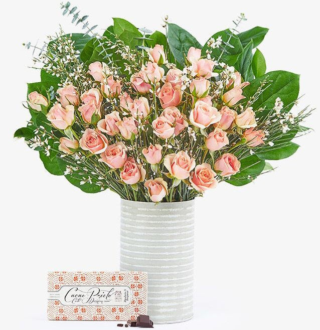 The bouquet comes with a Cacao Prieto Mandarin & Bergamot dark chocolate bar, the flowers, and a galvanized tin vase.Get them from BloomThat for $76 And if roses aren't their favorite flower, then check out our full list of the best places to buy flowers here.