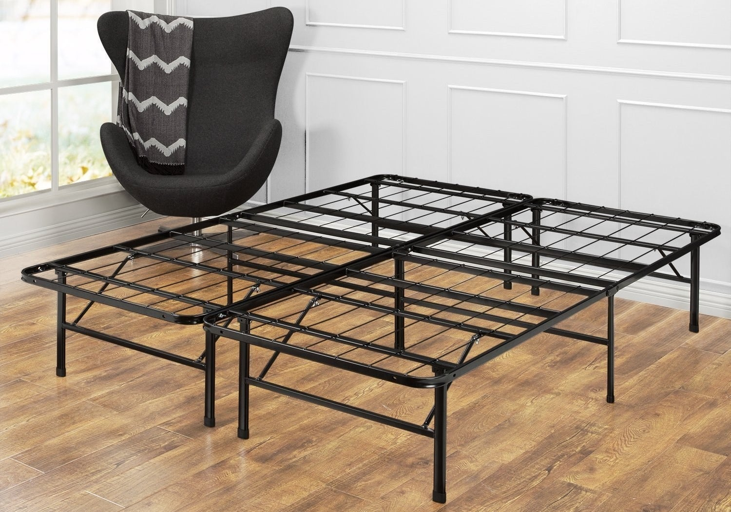 "Promising Review: ""I love this sturdy and simple bed frame! The frame is really cool because it collapses down in a matter of minutes. The frame is only two inches thick and can be carried out easily by one person. That would be great for home staging. But I use it all the time. It's totally worth the price!"" —CharlieGet it from Amazon for $58+ (available in seven sizes), Jet for $58+ (available in six sizes), or Walmart for $58+ (available in five sizes).You can read a full review of the bedframe here."