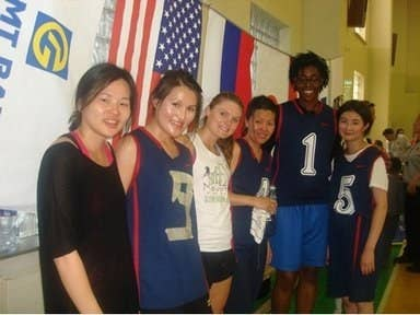 """Eva Riddick, second from right, former captain of the University of Delaware's Division 1 basketball team, says the worlds of college basketball and the Peace Corps have a lot more in common than you might think: both involve flexibility, adaptability, and resiliency. Riddick brought her love of basketball to her Peace Corps service and used it to help youth develop leadership skills and self-esteem. She initiated the Healthy Hoops Project with 50 Mongolian young people. """"Basketball was one of the few things in my community that was familiar. I was able to identify a passion that both my community and I shared, and subsequently built a strong foundation for my work at site,"""" said Riddick."""