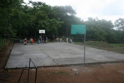 """Chris Norris came from a family with a tradition of military and public service, and he felt compelled to join the Peace Corps out of a fierce belief that optimism can change the world. As a volunteer in Costa Rica, Norris built a multi-use sports court at a high school. He hosted athletic camps with his community and regularly played soccer with local high school students. """"My Peace Corps 'itch' will probably never go away and I've decided that's just fine because to me that's the one thing I hope every volunteer brings home,"""" said Norris."""