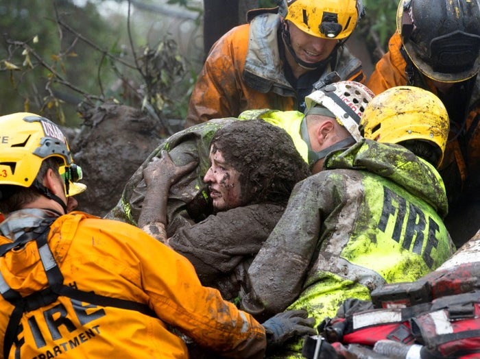 Emergency personnel rescue a woman from a collapsed house after a mudslide in Montecito, California, on Jan. 9.