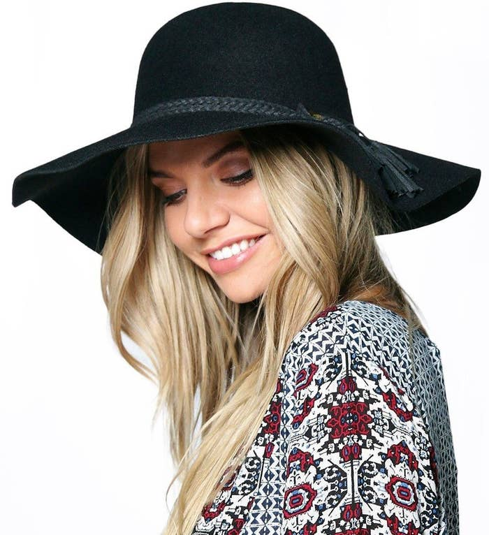 2ea65487 A floppy hat with tassel trim you can see yourself going to a lot of  farmer's markets in.