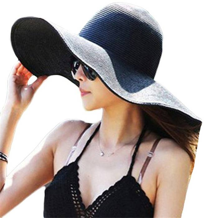 d1ec0a28 An oversized floppy hat for blocking out the sun and anyone who might try  to bother you while you're relaxing.
