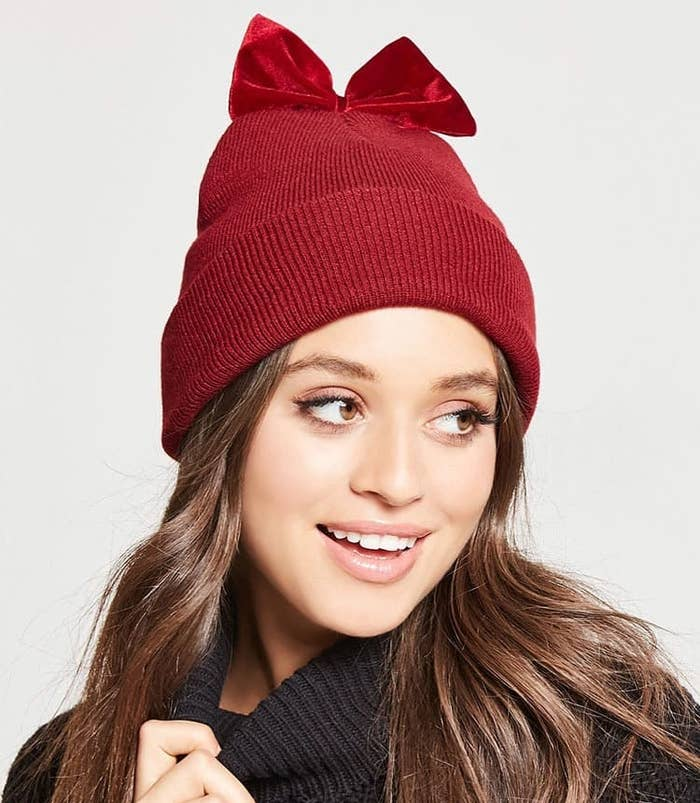 59eedc502d7f83 A charming beanie with a little velvet bow on top for a touch of cutesy  flair even on colder days.
