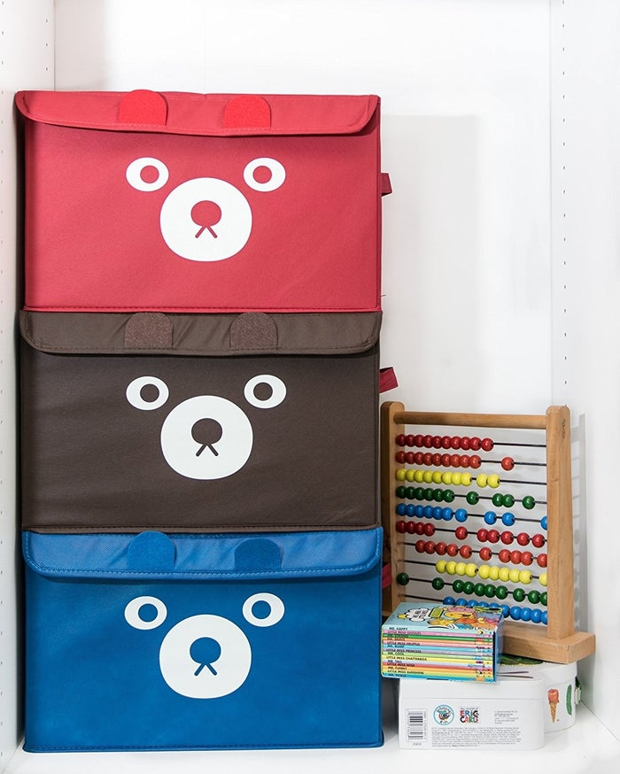 "Promising review: ""Our 1-year-old has so many toys, so we needed to find a simple solution to keep them tucked away when not in use. This bin was perfect. We've taught her how to put away her toys, and the bin is soft enough for her to use without us worrying about her hurting herself. We loved her bin so much that we decided to buy another. Unlike baskets, these can be stacked. Now we're even considering getting a couple more for Grandpa's house."" — R.G.Get them Amazon for $14.99+ each (available in five colors)."