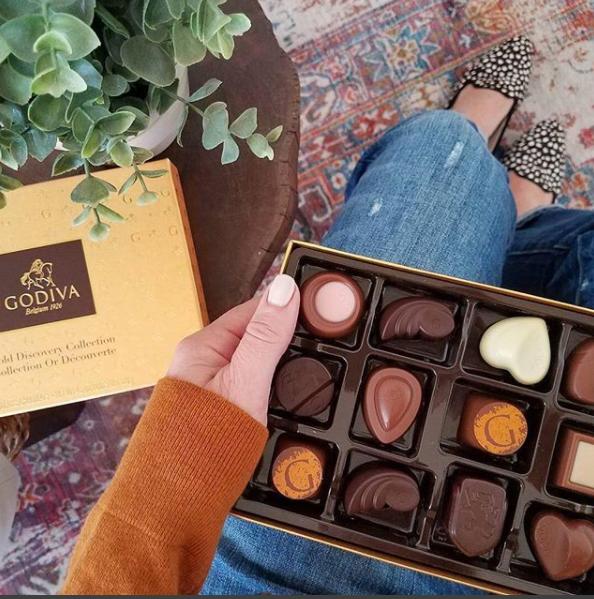 Hand holding box of chocolates
