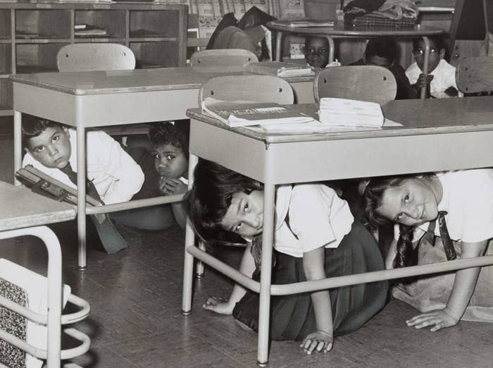 "Students at a Brooklyn middle school have a ""duck and cover: practice drill in preparation for a nuclear attack, 1962."