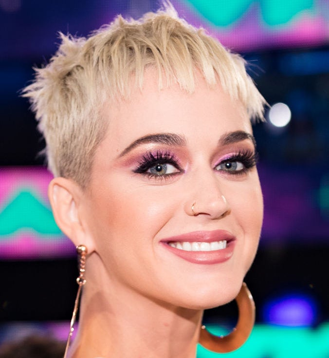 In a new interview with Refinery29, Katy Perry addressed the recurring tabloid rumors that she's had plastic surgery.