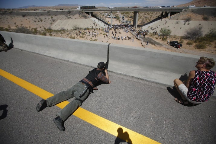 An armed Bundy supporter aims his weapon during the 2014 standoff near Bunkerville, Nevada.