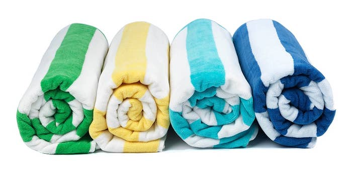 """Promising review: """"Great towels, especially for the price. Large beach towel size, very soft and quite thick. No problems washing or drying, colorfast. Was surprised by how nice these were, I've paid two to three times as much for similar quality towels. Will be buying more."""" –CharlesGet it from Amazon for $14.99+ (four colors)."""