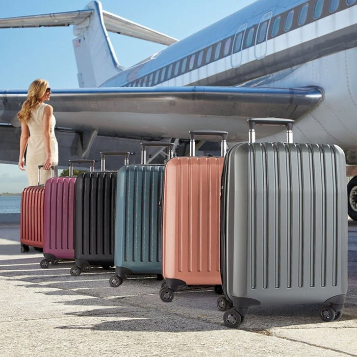 """Promising Review: """"I travel a lot, so I need a suitcase built to take abuse. I've owned this suitcase for a couple of years now and am still very happy with it. One thing they don't talk about on here that I'd like to mention is the handle. It is padded, so if you need to carry it up a flight of stairs, then your fingers aren't going to go numb or hurt from gripping hard plastic. The partition is great too. I use one side for my shoes, toiletries, and dirty clothes, then the other side with the straps for my clothes."""" —HollyGet it from Brookstone for $49.49 (originally $99; available in six colors)."""