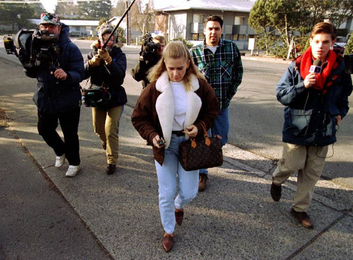 Tonya Harding is dogged by media as she leaves her Portland apartment to meet with her lawyers on Feb. 6, 1994.