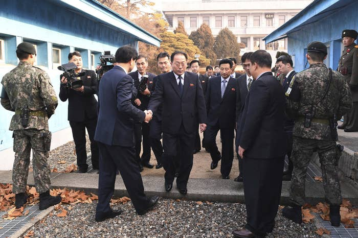 The head of a North Korean delegation crosses the border line to attend a meeting in the Demilitarized Zone in Paju, South Korea, this week.