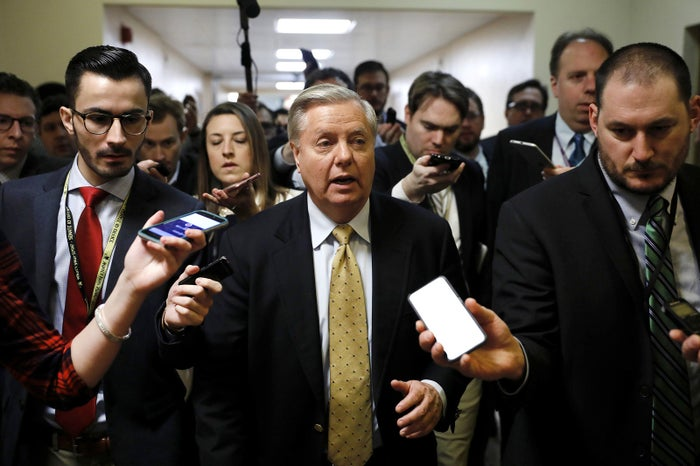 Republican Sen. Lindsey Graham of South Carolina speaks to reporters at the Capitol on Jan. 18. Congress is working to avoid a government shutdown ahead of a midnight Friday deadline.