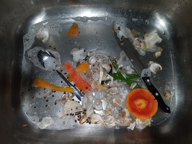 Scrub and sanitize the bottom of your kitchen sink.