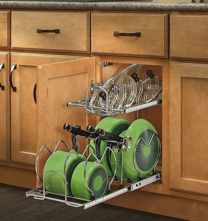 """Promising review: """"This is exactly what I needed. I have a standard 34"""" cabinet and all my pots and pans and lids took up the whole thing laying flat and stacked. My whole Costco set of pots and pans, lids, and lids from my casserole dishes fit nice and neat and I even had room to add another sliding bake-ware rack. Do yourself a favor: If you are thinking about getting one of these, stop thinking and do it."""" —Amazon CustomerGet it from Amazon for $77.99."""
