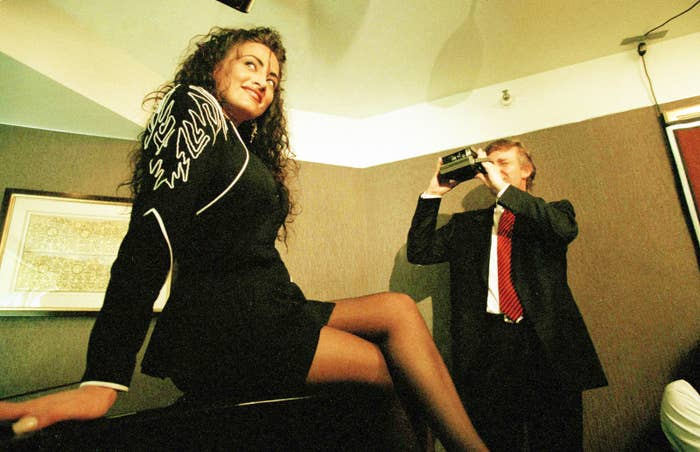 Donald Trump takes a picture of Playboy Playmate hopeful Lisa Madison during a publicity session 1993.
