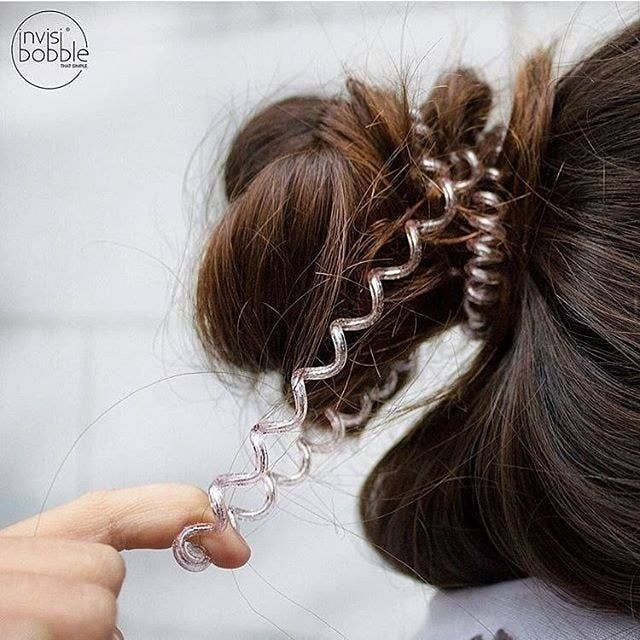 "Promising review: ""I'll never wear any other ponytail holder from now on! These work so well! My hair doesn't break and I'm constantly wearing it in a bun. I was surprised how well these worked and held my hair tightly in place. The best part is that after a day they shrink back to the size they originally started as."" —SarahSee our review here (#1).Get a pack of three from Amazon for $6.55 (see more colors here)."