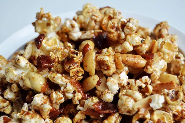 Here's one more genius thing to do with bacon fat — use it to make bacon peanut caramel corn.