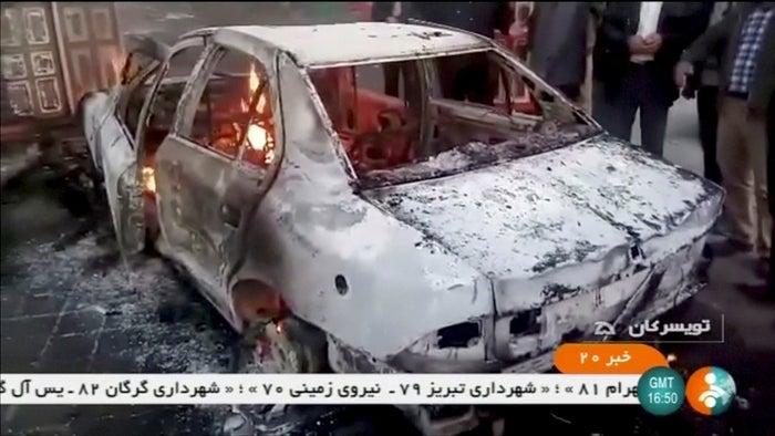 A burned-out car in Tuyserkan, Hamadan Province, Iran.
