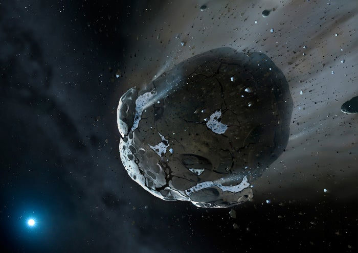 Artist impression of a rocky and water-rich asteroid being torn apart by the strong gravity of the white dwarf star GD 61.