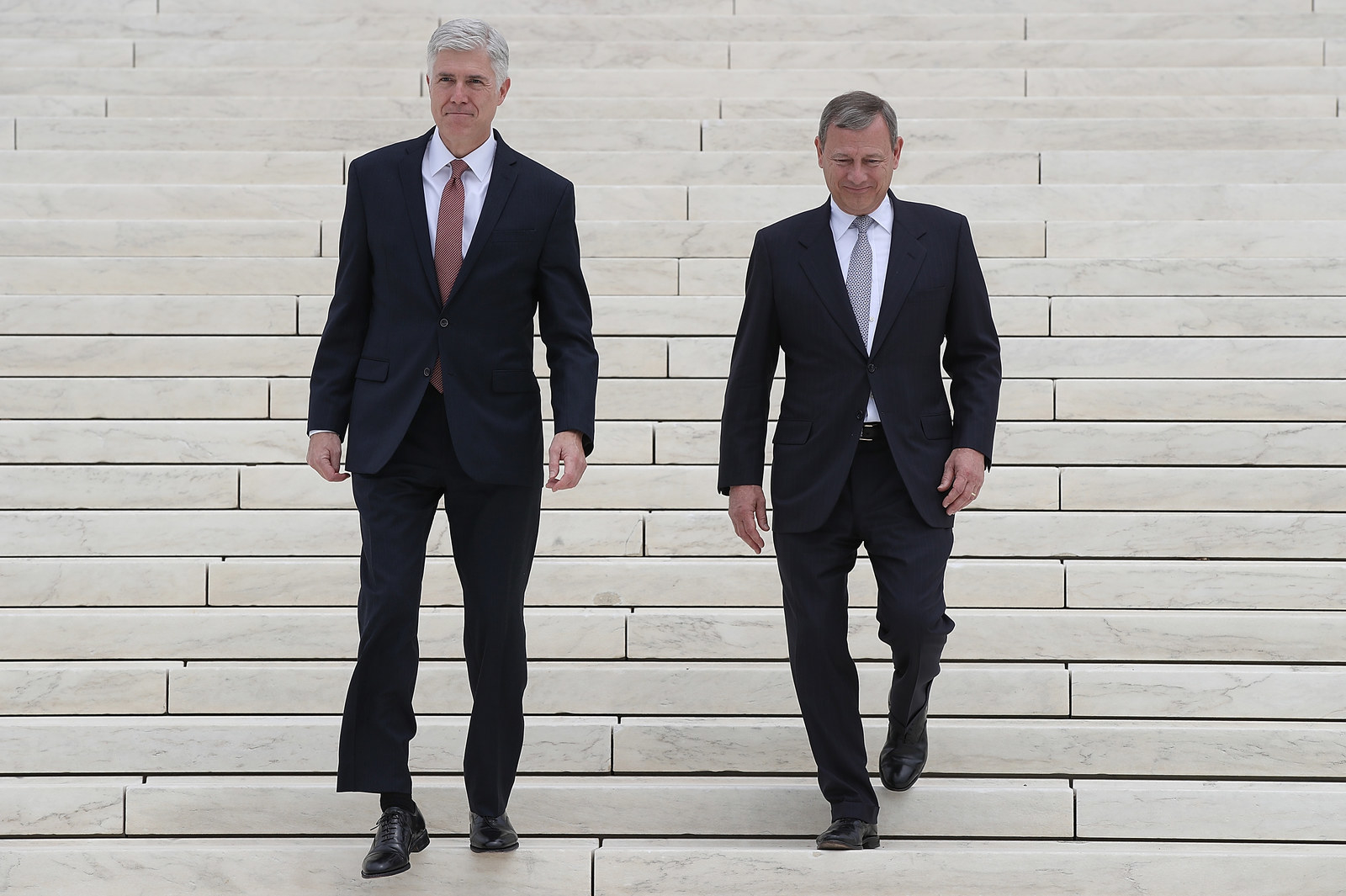 Roberts walks out of the Supreme Court with Neil Gorsurch last year.