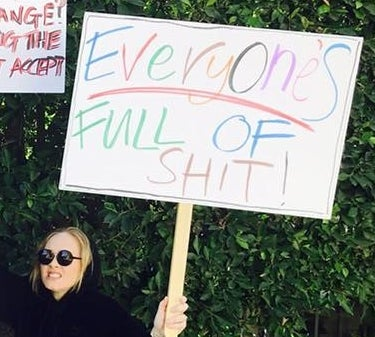 And, like, can we just appreciate Adele's sign? LOL!