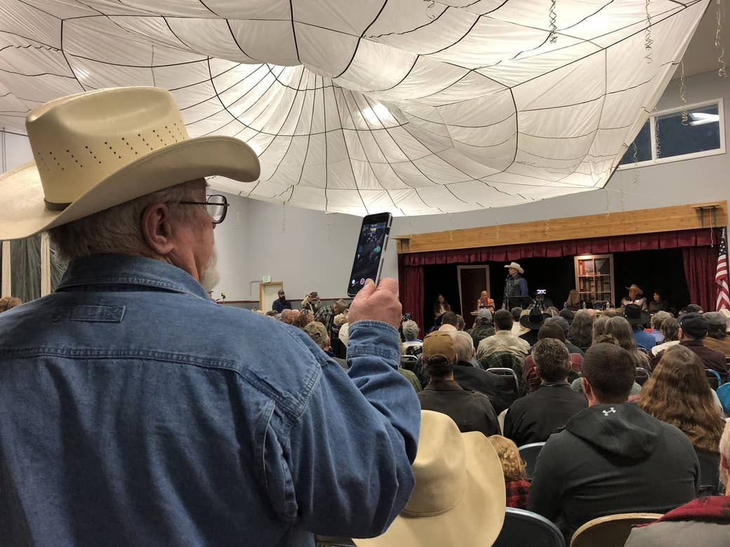 A man records a portion of Ryan Bundy's speech in Paradise, Montana.