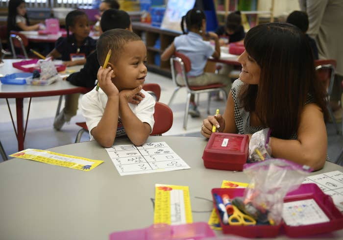 Elionet Saez Martin, of Puerto Rico, works with his kindergarten teacher at Chamberlain Elementary School in New Britain, Connecticut.