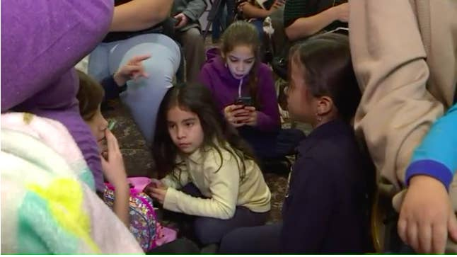 Puerto Rican families gather at a Red Roof Inn in Hartford, Connecticut, to learn about the fate of their temporary housing.