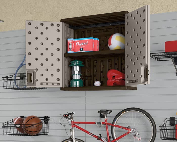 """This sturdy 30-1/4"""" wall storage cabinet has double-wall resin construction, one steel-reinforced shelf, lockable doors, and holds up to 75 lbs.!Promising review: """"We bought three of these for the garage. They're surprisingly sturdy and gave us much needed floor space by getting rid of a couple of sets of shelves."""" —TheCraftyWenchGet the cabinet from Amazon or Walmart for $85.99 and label maker from Amazon for $28.49"""