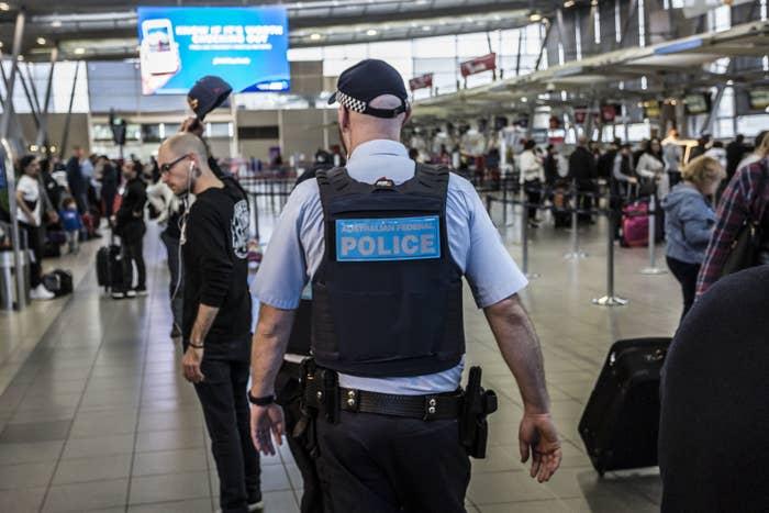 SYDNEY, AUSTRALIA - JULY 31: An Australian Federal Police officer on patrol at Sydney Domestic Airport