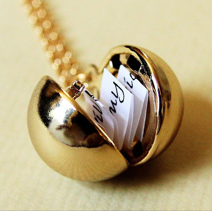 It comes with a little piece of paper that you can write your message on. The necklace has a 28-inch chain and comes with a jewelry box.Get it from Amazon for $20.