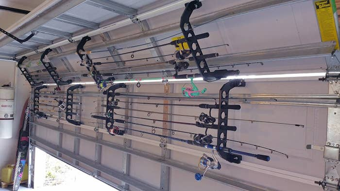 """Hardware included for easy, no tool installation on standard garage doors. If the door is a hard insulated or wood door, self tapping screws are not included but can be shipped at no cost. Can also be installed on walls and ceilings.Promising review: """"I love these racks. They work just like they say. I have two sets with all of my best poles. It works with my surf rods and with my casting rods wonderfully. I did have to move my hurricane braces down a couple of inches from the top edge of the panels. That was my door installer's fault for trying to save on screws. I have no problems with mine falling out and I use my garage like a front door."""" —amoGet them from Amazon for $35 (available in two sizes), Walmart for $34.99 (one size), or The Home Depot for $34.69 (one size)."""