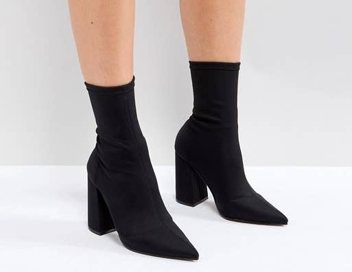 bd6713445a0 A pair of high-heeled sock boots for the stylish stunna who loves a modern  twist on a classic black boot.