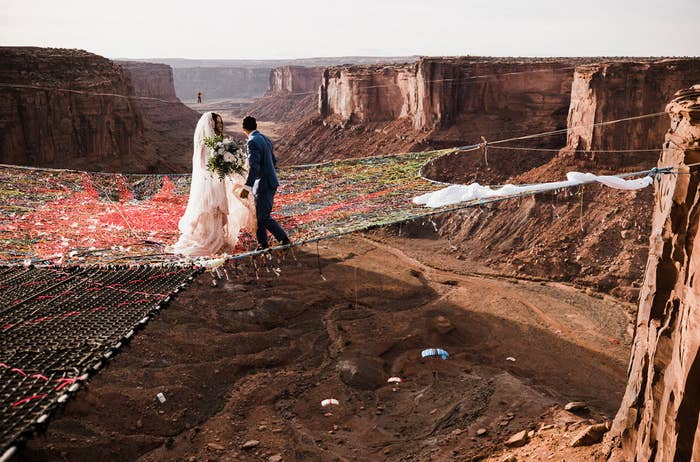 That's about 400 feet — or a football field PLUS forty more feet — in the Fruit Bowl highline area near Moab, Utah. Kim and Ryan go to the canyon every year for a slacklining festival that was both their second date *and* where they got engaged! (Slacklining's a sport that's kinda like tightrope-walking.)