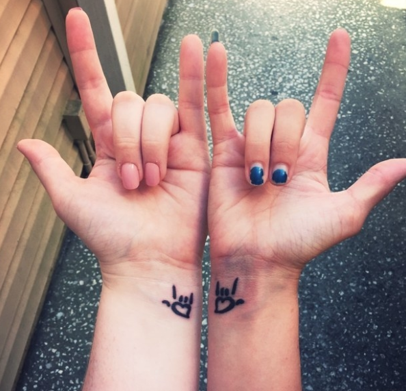 """""""My sister and I got matching tattoos before I moved out of state, to symbolize our love for each other!""""—stephaniec40c5dd71d"""