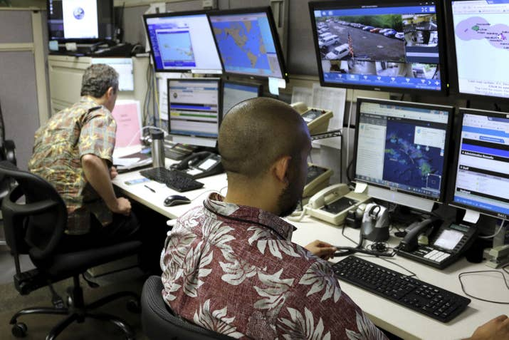 Hawaii Emergency Management Agency officials at the command center in Honolulu.