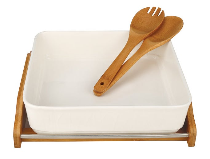 A porcelain baking dish with its own heat-, stain-, and water-resistant bamboo rack and utensil set.
