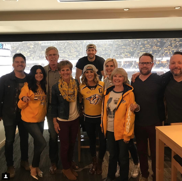 """And when she enjoyed this """"game"""" night in private box seats watching her now-retired Nashville Predators hockey player Mike Fisher, aka her hubby, definitely not like you."""