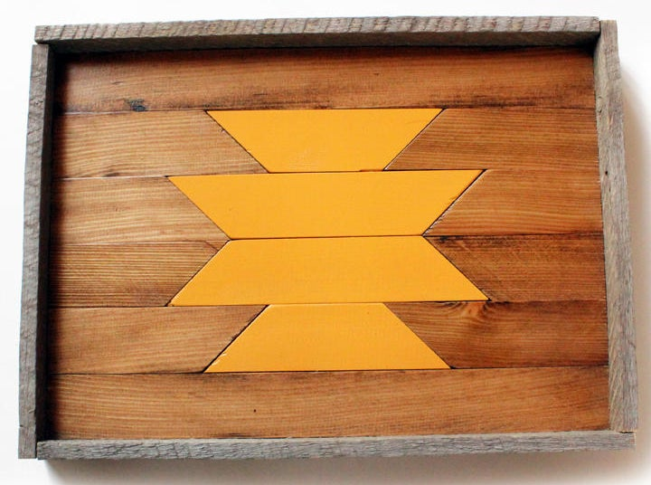 A handmade, water-resistant serving tray crafted from reclaimed wood.