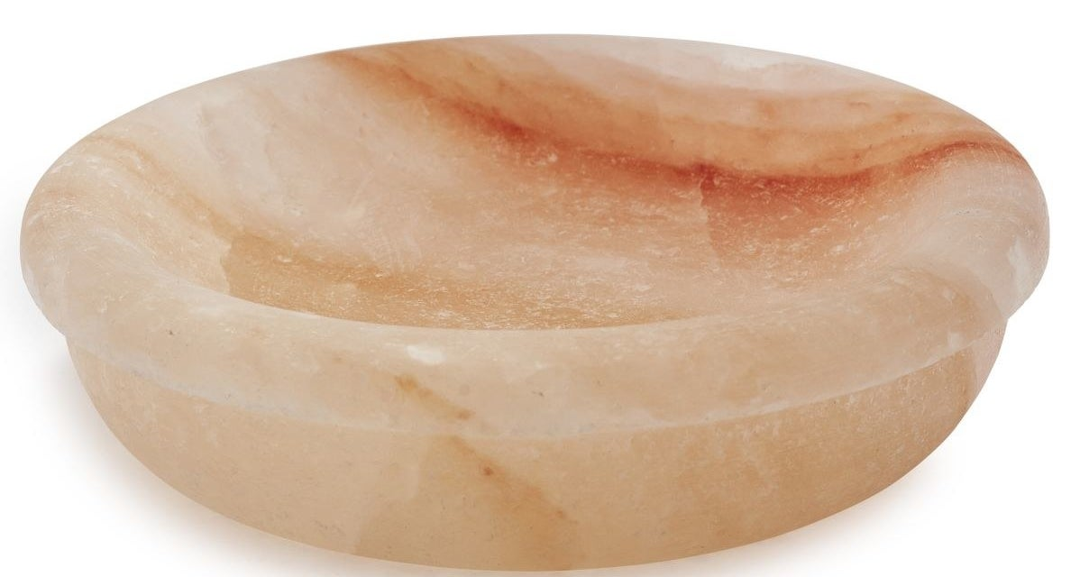 A Himalayan salt bowl that can handle extreme temperatures for a unique way to serve dips.