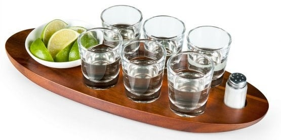 A high-quality shot glass tray, since you're not in college anymore and your guests deserve to celebrate like adults.