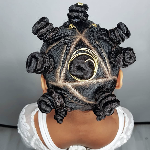 Let's count the many ways this style bangs: the secure swirls, the geometric parts, the precise braids, and the perfect accessories.