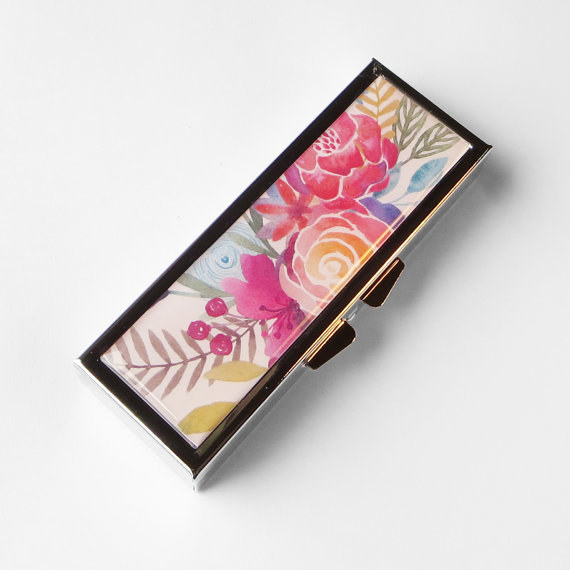 This floral pill case that's as cute as any clutch.