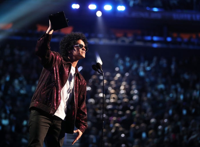 Bruno Mars accepts the award for Album of the Year during the Grammy Awards on Jan. 28 in New York City.