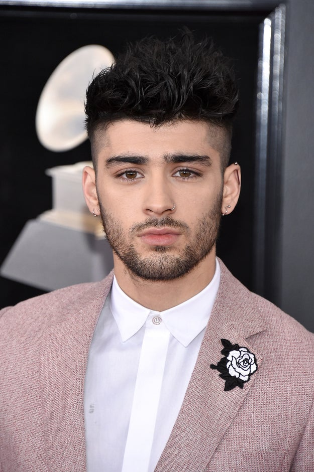 And not only did Zayn look hot AF in his pink suit, he also had a white rose embroidered on it to show support for the #MeToo and Time's Up movement.